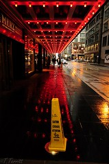 Slippery when Wet (Tommy6unz) Tags: red chicago cold reflection bus one town nikon day pass caution redeye around raining gapersblock palmerhouse chicagoist d5000 1685mm