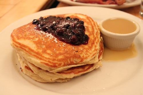 Blueberry pancakes with maple butter syrup