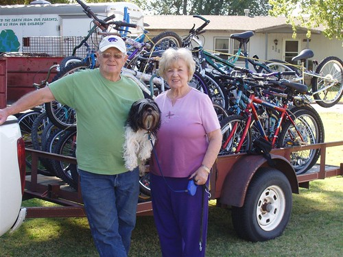 Earth Team Volunteer Robert Mosier and his friend Marcella Thomas stand in front of a trailer full of refurbished, soon-to-be-donated bicycles with Jack the dog.  NRCS recognizes Robert as its top volunteer for 2011.