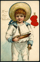 Old Valentine sailor boy holding toy sailboat (oldsailro) Tags: park old boy sea summer people sun lake playing beach water pool girl sunshine youth sailboat race vintage children fun toy boat miniature wooden pond model holding waves sailing ship child time yacht antique group valentine boom mat regatta sailor hull spectators watercraft adolescence keel fashioned