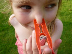 Nose Clip (Liskabub) Tags: orange green girl nose person scotland funny child hand looking young clip cousin peg 2010 squashed gifford washingline contorted springlookingaway