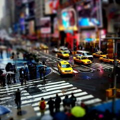 Times Square at 45th St. (jeremypix) Tags: street new york city nyc ny rain yellow square dof taxi shift taxis squareformat times tilt taxicab taxicabs 45th iphone top20nyc iphoneography tiitshift instagramapp uploaded:by=instagram