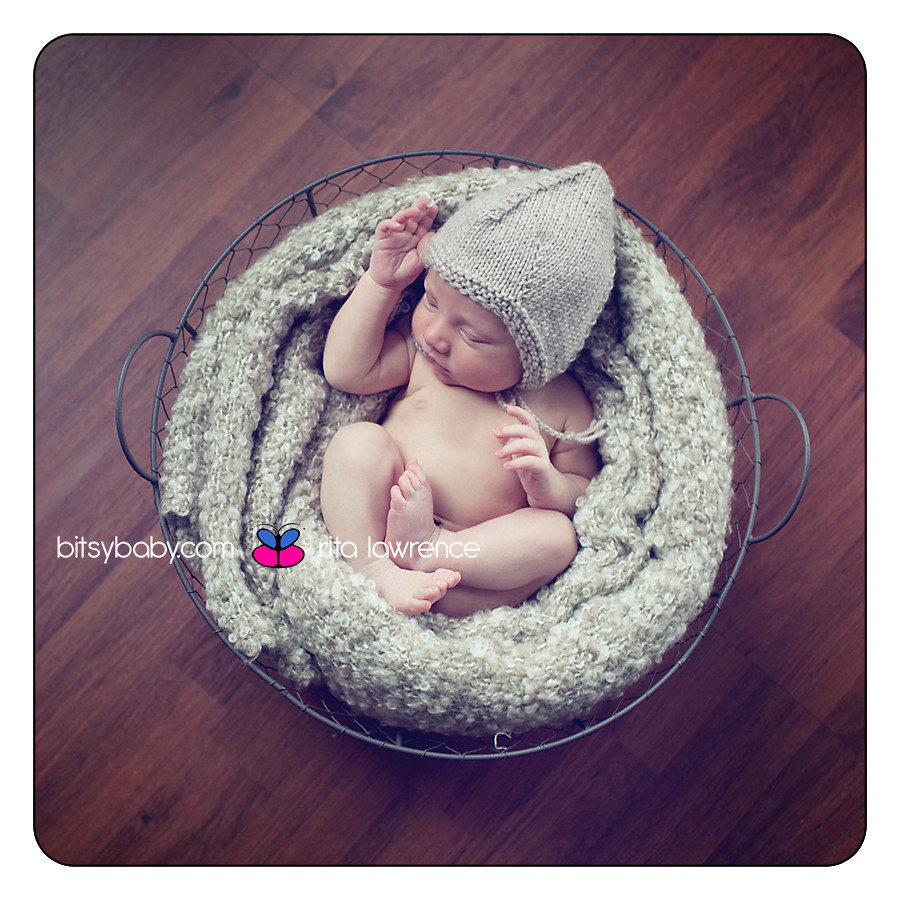 newborn photography in wire basket