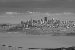 bridges and city under a dark sky (grwsh.marcel) Tags: sanfrancisco city sky bw canon dark oakland bay san francisco view under bridges goldengatebridge vista uitzicht zwart wit 100400mm blackdiamond zw oaklandbaybridge 40d canon40d
