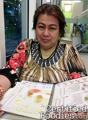 My mother posing while looking over Bubble Tea's menu - CertifiedFoodies.com