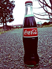 Coca-Cola standoff (Vorona Photography) Tags: poverty street red urban usa white cold color macro classic beauty sunshine childhood sign cane price youth trash america real concrete town washington garbage artwork energy view cola symbol drink juice thing united memories poor beverage dream royal free dump happiness coke korea retro sugar corporation clear mexican nostalgia crisp costco americana times tacoma taste cocacola states tradition viewpoint refreshing iconic ghetto alternative decaying symbolic softdrinks coka streetlevel glassbottle transnational lowincome hfcs