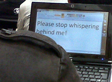 Please stop whispering behind me!