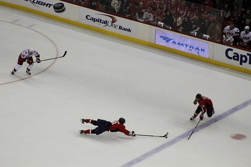 Alex Ovechkin extends to keep the puck in the zone on the power play.