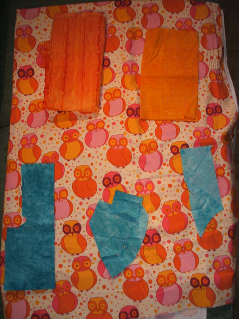 Owl quilt qith oranges and blues