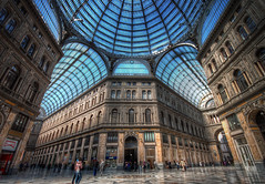 Galleria Umberto I (TheFella) Tags: travel blue sky people italy detail building slr public glass yellow architecture digital photoshop canon mall shopping eos gold photo high italian europe king italia gallery day dynamic interior landmarks landmark clear photograph dome shoppingmall processing napoli handheld naples daytime inside dslr range umberto hdr highdynamicrange galleria thegallery postprocessing 500d glassdome southernitaly galleriaumbertoi galleriaumberto photomatix umbertoi shoppinggallery hdrs handheldhdr risanamento emanuelerocco johnhorneburns napleslandmark napolilandmark italianshoppingcentre italianshoppingcenter