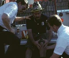 Paramedics tend to an injured firefighter from FS 17 Circa 1970s