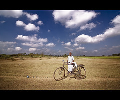 Empty dreams (MRK Clicks) Tags: blue white man field bicycle clouds nikon looking path streetphotography chennai tamilnadu mrk kalki d40  emptydreams  tokina1116mm mrkclicks bestof2011 thiruvancheri mrkbest 10best2011