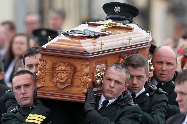 Police Officers Carry the Coffin of Constable Ronan Kerr