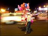 Balloon guy 1 (Mazetta) Tags: road street city urban blur night asia traffic south balloon east vietnam chi mopeds scooters ho minh saigon seller cotcpersonalfavorite