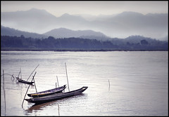 mekongdreamz (biancavanderwerf) Tags: wood travel mist water river landscape boats three bianca laos mekong reizen earthasia