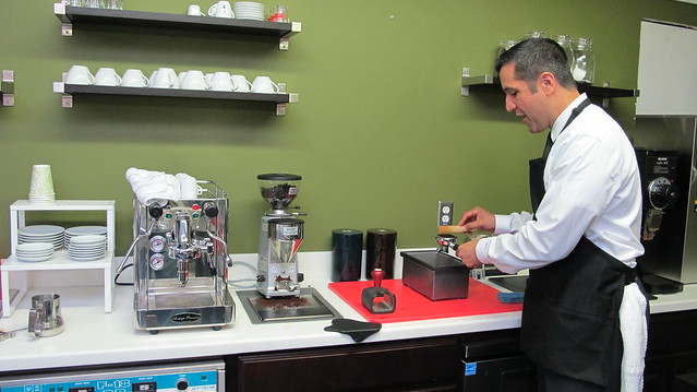 J. René demonstrating espresso making.