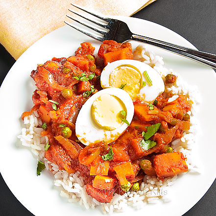 Sweet Potato Curry in Tomato Sauce with Hard-Boiled Eggs on plate