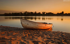 Beached (.Brian Kerr Photography.) Tags: trees light sunset sun canon reflections river landscape boat sand glow warmth shore cumbria cumbrian rockcliffe rivereden saariysqualitypictures eos5dmkii briankerrphotography
