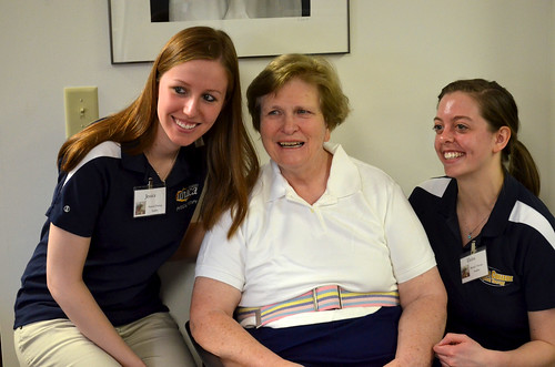 Jessica Hulse '12 and Elaina Mazzola '11 discuss how to teach a client to use a new type of cane.