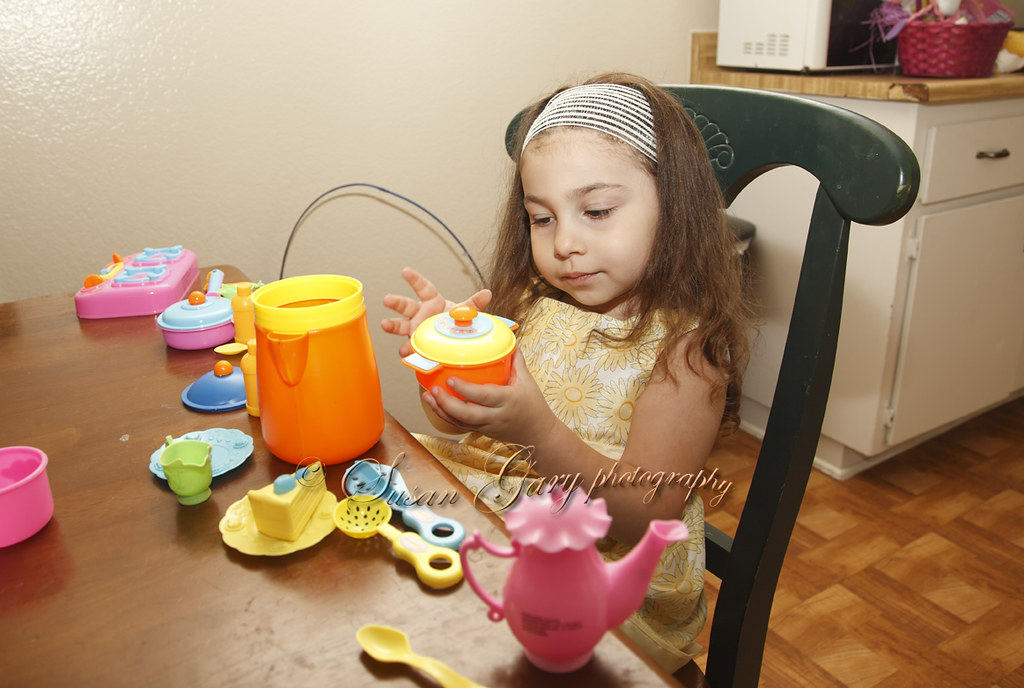 Toddler Girl Playing with Easter Toys