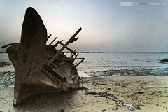 wrecked (erickespinosa) Tags: sea storm rain boat ship abandon wrecked doha qatar wakra