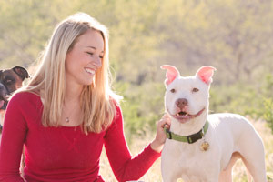 Woman with white pit bull dog
