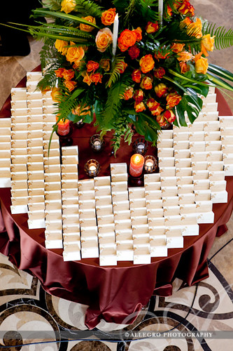 david-tutera-my-fair-wedding-ny-book-details- orange roses yellow roses tropical plants palm leaves escort card table