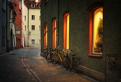 Streets of Regensburg (boggdanx) Tags: europeonflickr regensburg city urban urbanexplorer bikes streetphotography street aley citylights center bicycles vignette scene downtown sigma1750mm nikond7100