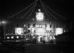 21; General Post Office decorated with flags and lights to commemorate King George VI - 1935 (Wellington City Council) Tags: wellington historicwellington 1800s 1900s 1950s