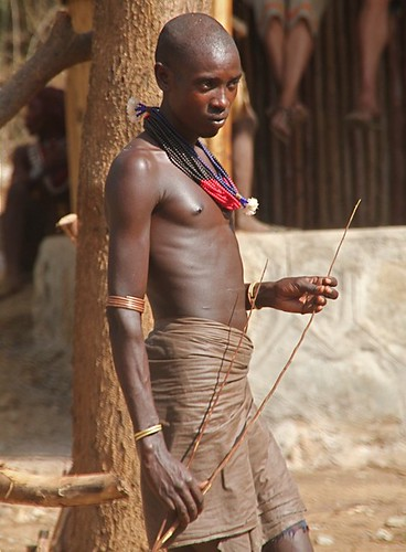 Man ready to beat the unmarried girls, Hamar Bull Jump, Ethiopia