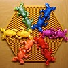 Friendly Frolicking Froggies (fillzees) Tags: blue red stilllife orange green motif colors animal yellow catchycolors toy rainbow kiss violet amphibian symmetry frog hexagon symmetrical multicolored honeycomb tabletop silicone