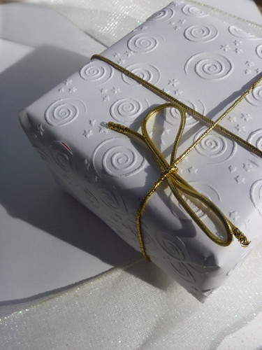 White Embossed Gift Wrapped Present