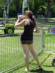 Bottled Water (Brave Heart) Tags: ca water girl fence drinking picture fair bottledwater flipflops shorts ponytail countyfair pleasanton alamedacountyfair hotday drinkingwater hotsun girldrinking pleasantoca