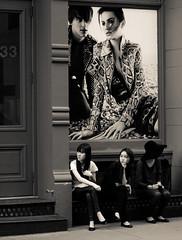 wish and wait - new york city (pamela ross) Tags: street girls woman usa house newyork building america pen bench poster 50mm ballerina waiting asia unitedstates minolta candid soho olympus advert wish ep1 streetphotographycandidstreetportrait