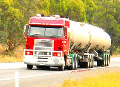photo by secret squirrel (secret squirrel6) Tags: new trees red beautiful lines moving cabin photos transport worker trailer grille seymour bog tanker ashphalt loaded lanes northbound truckdriver argosy gaurds freightliner cabover bullbar flatroof ruralaustralia humehighway bdouble triaxle roundheadlights roundtanks bogiedrive finemore secretsquirreltrucks
