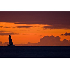 Sailing into the Sunset (Johan J.Ingles-Le Nobel) Tags: sunset red sea orange silhouette boat sailing ship crystalcove barbados sail outline johanjingleslenobel barbadoscrystalcove yahoo:yourpictures=waterv2