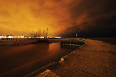 North Avenue Beach Jetty and Lighthouse (Seth Oliver Photographic Art) Tags: sunset chicago night clouds reflections illinois nikon midwest nightimages cloudy piers silhouettes cityscapes lakemichigan nightshots beautifulclouds pinoy stormclouds cookcounty nightscapes urbanscapes secondcity nightexposure jetties northavenuebeach longexposures chicagoist breakwaters goldcoastneighborhood d90 10secondexposure wetreflections thewindycity cityofchicago cityofbigshoulders springinchicago aperturef100 manualfocusmode softvignette setholiver1 manualexposuremode nocturneimages 1024mmtamronuwalens timedelaytriggeredshot northavenuejettyandlighthouse springstormsoverchicago miniballheadtripodmountedshot