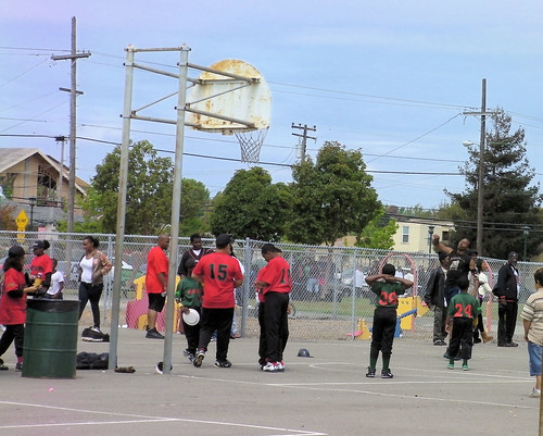 Uniformed players from some of the five Little League teams in North Richmond play basketball at Shields-Reid Park on Saturday during the North Richmond Green celebration. Three baseball games were played on the neighboring ballfield.
