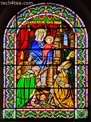 Stained glass window in Provencal church.