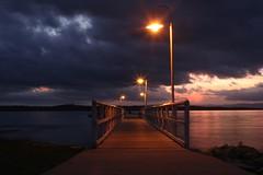 Lit Up (pominoz) Tags: light sunset lake pier jetty wharf nsw lakemacquarie murraysbeach