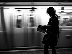 Reading shadow (sjmgarnier) Tags: newyorkcity shadow people woman usa newyork blur station silhouette magazine underground subway reading movement manhattan april portfolio subwaystation youngwoman ftrain undergroundstation readingmagazine 2011 bwstreetphotography