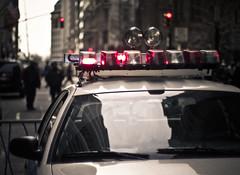 police car // new york (pamela ross) Tags: street nyc urban usa cloud newyork reflection car pen 50mm lights trafficlight dof minolta bokeh pov perspective police olympus siren ep1