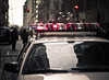 police car // new york (pamela ross) Tags: street nyc urban usa cloud newyork reflection car pen 50mm lights trafficlight dof minolta bokeh pov perspective police olympus siren ep1