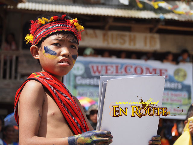 An Ifugao Kid prepares their props