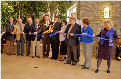 Cutting the ribbon on the PioneerCare facility in Fergus Falls, Minn. The 105-bed senior care center was financed with over $21 million in Recovery Act loans.