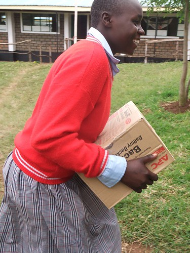 An Enoosaen Girls' Secondary pupil helps unload