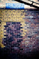 Back Turner Brickwork (light_arted) Tags: uk blue brick yellow wall manchester back paint pipe tiles lane turner eos5d ef24105f40l