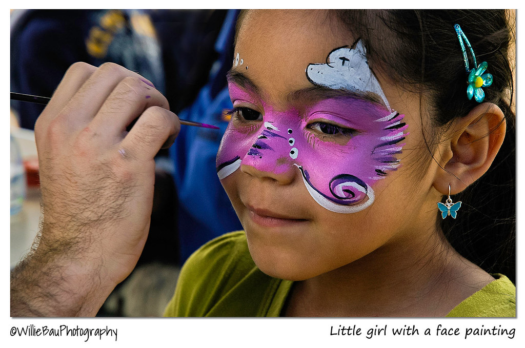 Little girl with a face painting.