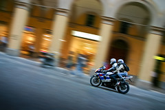 Japanese Tourist (Suzuki & Arcades Panning Blur), Bologna (flatworldsedge) Tags: two people italy blur ride motorbike riding bologna suzuki arcades panning pillion acceleration yahoo:yourpictures=motion