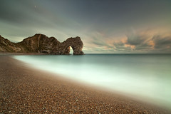 Durdle Door (peterspencer49) Tags: ocean greatbritain sea england seascape clouds coast europe britain dusk steps pebbles worldheritagesite dorset stunning limestone coastline seaview coastalpath westcountry seaarch southwestcoast durdledoor southwestcoastalpath stunningview seascene jurasiccoast oceanveiw limestonearch 5dmkll peterspencer unitedkingdem stunningseascape beachseaview